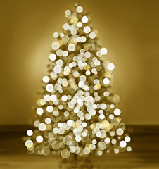Bokeh silhouette of Christmas tree, gold tone