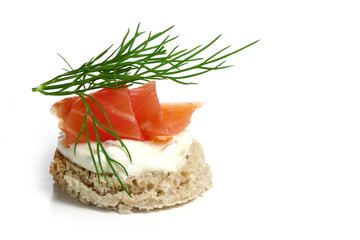 canape wiht salmon and  dill garnish,  isolated on white