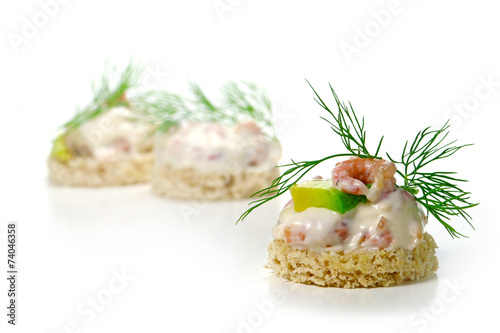 Leinwanddruck Bild canapes with shrimp cocktail, avocado and  dill garnish, isolate