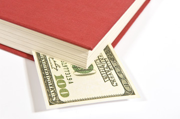 Red Book With Hundred Dollar Bill and Shadow