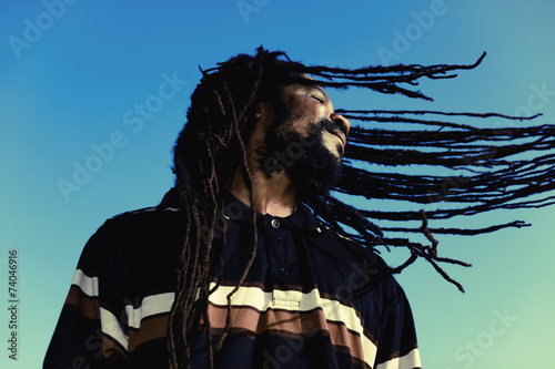 "Happy man with ""windy"" dreadlocks. Caribbeans. - 74046916"