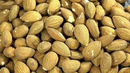 Rotating Almonds as seamless loopable 4K background footage