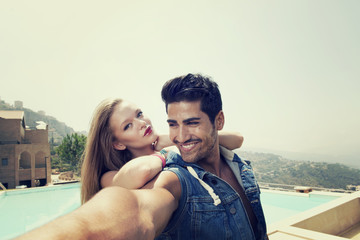 Beautiful Couple taking selfie with their Phone
