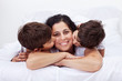 Happy mother and her loving little boys