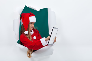 Little santa girl using tablet computer - with copy space