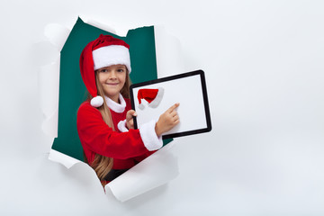 Opening the holidays season online - little girl with tablet com