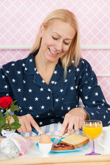 Woman breakfast on bed