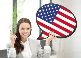 smiling woman with text bubble of american flag