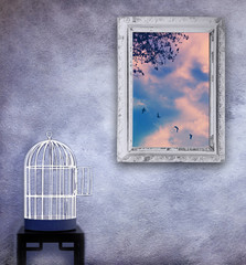 Birds escape from the cage, freedom concept