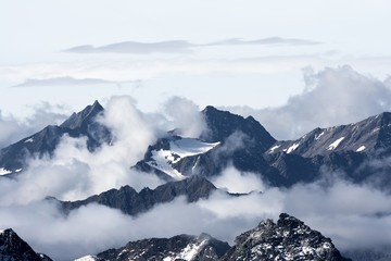 Jagged mountain peaks above the clouds
