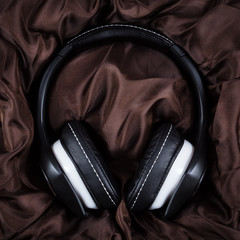Headphones on textile background