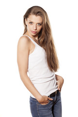 beautiful young woman in jeans posing on a white background