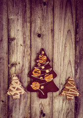 Chocolate christmas tree on wooden background