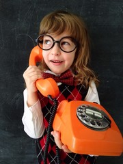 child speaking by the phone