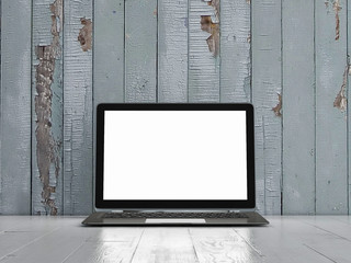 Mock up laptop on wooden table,blue background