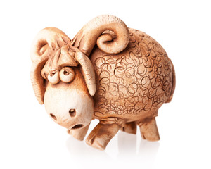brown ceramic ram doll isolated on white background