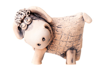 brown ceramic sheep statuette isolated on white background