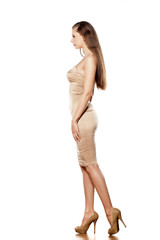 SIde view of young pretty woman in tight short dress