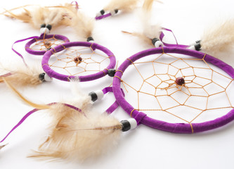 Purple dreamcatcher close up on white background