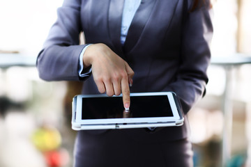 Close up image of a business woman using a tablet pc.