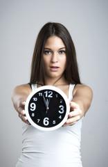 Surprised Girl Holding Alarm Clock