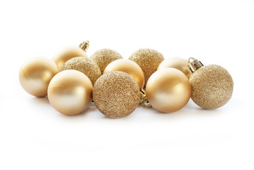 Gold Christmas ball decorations on white background