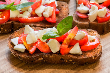 "Italian bread called ""Bruschetta"" with tomato, mozarella"