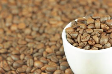 Coffee mug full of coffee beans