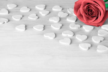 One rose and wooden hearts