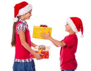 two kids with Christmas gift boxes
