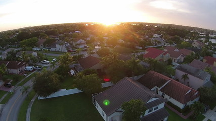 Sunset over suburna Florida homes aerial view