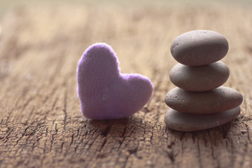 Zen stones and violet Heart on wooden - Stock Image