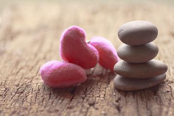 Zen stones and violet Heart on wooden - Stock Image