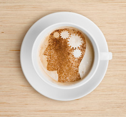 Coffee cup with brain on foam. Refreshing concept.