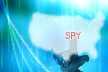 Spy on American digital concept with hand wearing black glove to