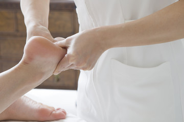 Women undergoing foot massage