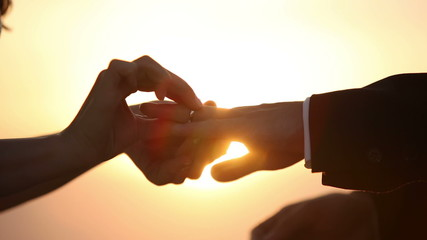 Lovers wear each other ring as a token of love