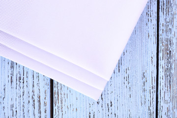 White napkins on wooden table