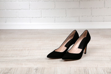 Black women shoes with  on the floor