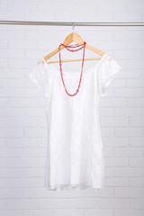 Female dress on hanger  in room