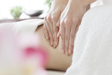 Women undergoing massage squeezing the flab