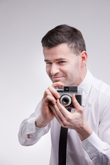 photographer with an oldstyle analogue photocamera shooting phot