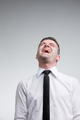 man laughing out loud with a necktie