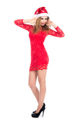 Young woman in red dress and santa hat. christmas