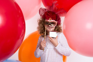 Girl in a mask drinking a beverage out of the box without inscri