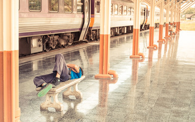 man sleep in Passenger platform at  the railway station