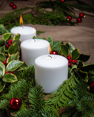 Evergreen Christmas centerpiece with white candles