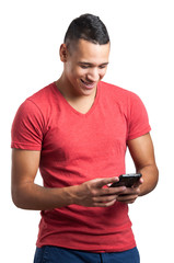 Portrait Of Happy Young Man Writing On Cell Phone