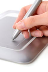 Female hand, making use of pen tablet