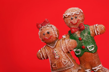 Gingerbread Couple over Red Background. Christmas Cookies